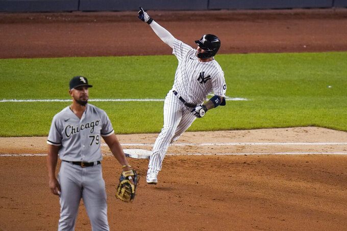 New York Yankees' Gleyber Torres runs the bases after hitting a home run, near Chicago White Sox first baseman Jose Abreu during the seventh inning of a baseball game Friday, May 21, 2021, in New York. (AP Photo/Frank Franklin II)