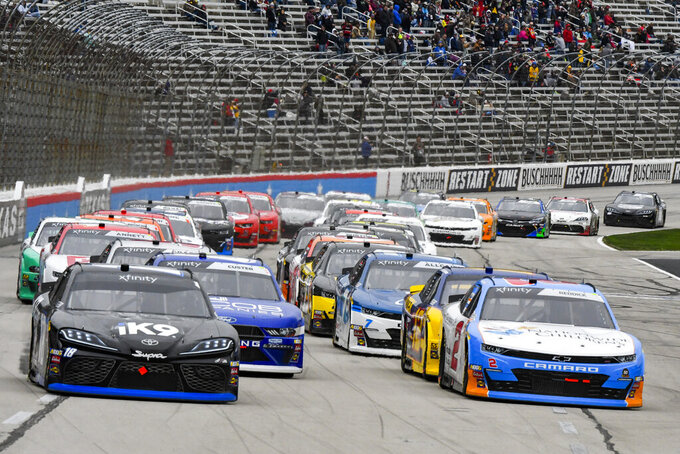 Driver Kyle Busch (18) and Tyler Reddick (2) lead the field during a restart of a NASCAR auto race at Texas Motor Speedway, Saturday, March 30, 2019, in Fort Worth, Texas. (AP Photo/Larry Papke)