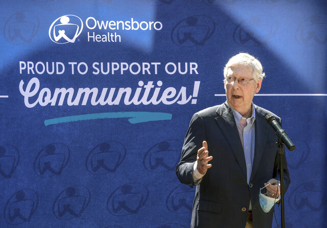 U.S. Senate Majority Leader Mitch McConnell speaks outside of the Owensboro Health Muhlenberg Community Hospital during a press conference, Tuesday, July 14, 2020, in Greenville, Ky. McConnell made the appearance to express his gratitude for Kentucky's front-line healthcare workers and to discuss the impact of the Coronavirus Aid, Relief, and Economic Security Act. (Greg Eans/The Messenger-Inquirer via AP)