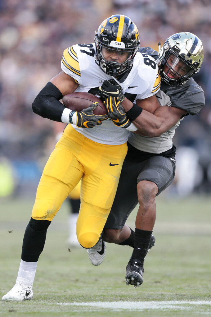 Iowa tight end Noah Fant, left, is tackled by Purdue safety Navon Mosley in the first half of an NCAA college football game in West Lafayette, Ind., Saturday, Nov. 3, 2018. (AP Photo/AJ Mast)