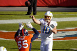 Los Angeles Chargers quarterback Justin Herbert (10) throws over Denver Broncos outside linebacker Bradley Chubb (55) during the first half of an NFL football game, Sunday, Nov. 1, 2020, in Denver. (AP Photo/Jack Dempsey)