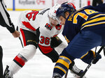Buffalo Sabres forward Rasmus Asplund (74) and Ottawa Senators forward Colin White (36) take a faceoff during the first period of an NHL hockey game Saturday, Nov. 16, 2019, in Buffalo, N.Y. (AP Photo/Jeffrey T. Barnes)