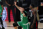 Boston Celtics' Daniel Theis (27) celebrates a dunk in front of Toronto Raptors' Pascal Siakam (43) in the second half of an NBA conference semifinal playoff basketball game Thursday, Sept 3, 2020, in Lake Buena Vista Fla. (AP Photo/Mark J. Terrill)