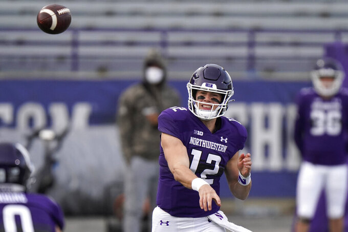 Northwestern quarterback Peyton Ramsey throws a pass during the first half of an NCAA college football game against Wisconsin in Evanston, Ill., Saturday, Nov. 21, 2020. Northwestern won 17-7. (AP Photo/Nam Y. Huh)