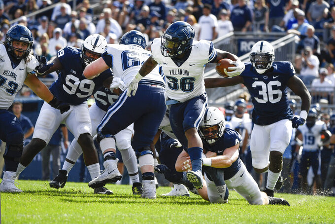 Villanova running back Jalen Jackson (36) steps out of tackle-attempt by Penn State linebacker Tyler Elsdon (43) during an NCAA college football game in State College, Pa., on Saturday, Sept. 25, 2021. (AP Photo/Barry Reeger)