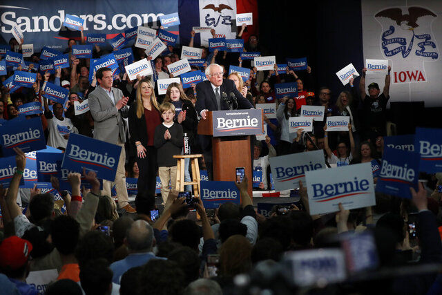 Democratic presidential candidate Sen. Bernie Sanders, I-Vt., accompanied by his family, speaks to supporters at a caucus night campaign rally in Des Moines, Iowa, Monday, Feb. 3, 2020. (AP Photo/Pablo Martinez Monsivais)