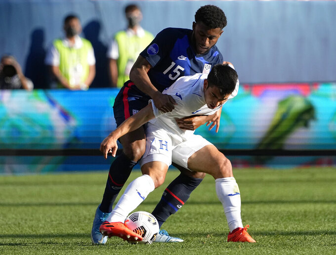 United States' Mark Mckenzie (15) pressures Honduras' Diego Rodríguez during the first half of a CONCACAF Nations League soccer semifinal Thursday, June 3, 2021, in Denver. (AP Photo/Jack Dempsey)