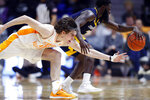 Tennessee forward John Fulkerson (10) attempts to steal the ball from Chattanooga guard David Jean-Baptiste (3) during the second half of an NCAA college basketball game Monday, Nov. 25, 2019, in Knoxville, Tenn. (AP Photo/Wade Payne)