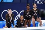 From left, Grace McCallum, Jordan Chiles, Simone Biles, and Sunisa Lee of the United States wait their turn to train on vault for artistic gymnastics at Ariake Gymnastics Centre venue ahead of the 2020 Summer Olympics, Thursday, July 22, 2021, in Tokyo, Japan. (AP Photo/Ashley Landis)