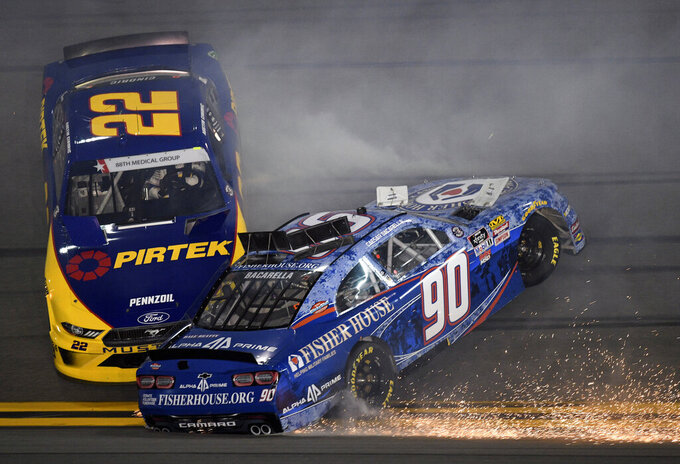 Austin Cindric (22) and Caesar Bacarella (90) collide as they get caught up in a crash coming out of Turn 3 during a NASCAR Xfinity Series auto race at Daytona International Speedway, Friday, July 5, 2019, in Daytona Beach, Fla. (AP Photo/Rob Sweeten)