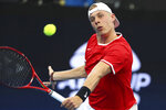 Denis Shapovalov of Canada plays a shot during his match against Stefanos Tsitsipas of Greece at the ATP Cup tennis tournament in Brisbane, Australia, Friday, Jan. 3, 2020. (AP Photo/Tertius Pickard)