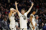 Purdue forward Evan Boudreaux (12), guard Sasha Stefanovic (55) and guard Nojel Eastern (20) celebrate during the second half of the team's NCAA college basketball game against Iowa in West Lafayette, Ind., Wednesday, Feb. 5, 2020. Purdue defeated Iowa 104-68. (AP Photo/Michael Conroy)