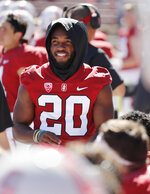 Stanford running back Bryce Love (20) hangs out on the sidelines with an injury in the first half in an NCAA college football game in Stanford, Calif., Saturday, Sept. 15, 2018. (AP Photo/Jim Gensheimer)