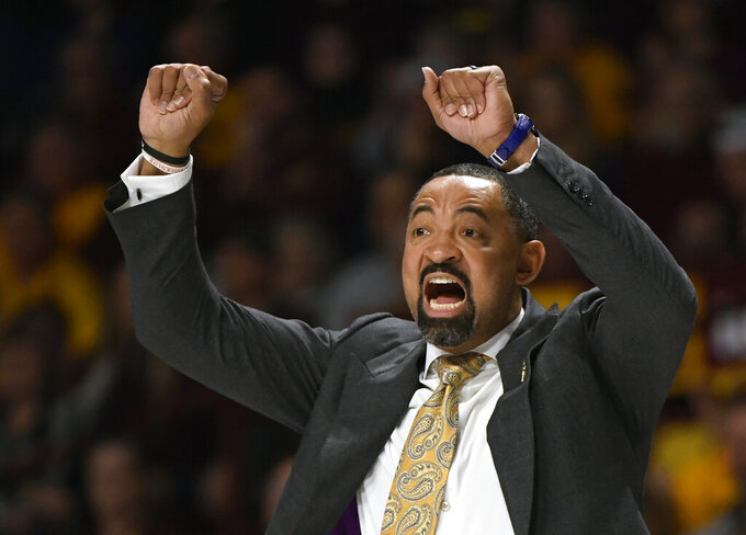 Michigan head coach Juwan Howard shouts as his team plays Minnesota in the second half during an NCAA college basketball game on Sunday, Jan. 12, 2020, in Minneapolis. (AP Photo/Hannah Foslien)