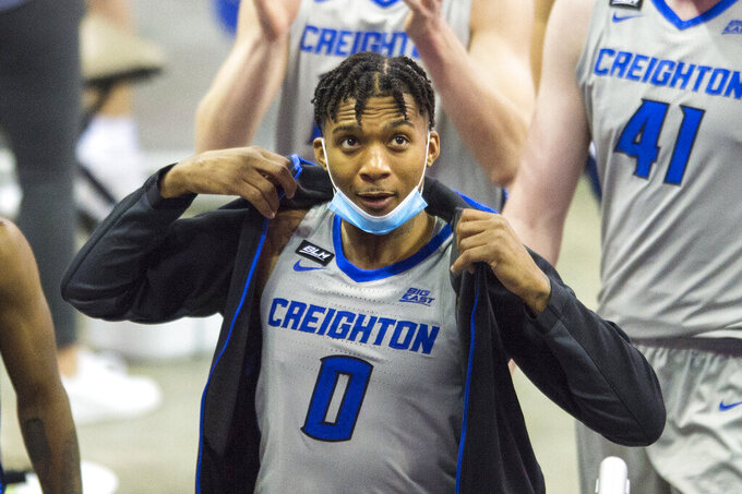 Creighton's Antwann Jones puts on a sweat jacket as he leaves the court after defeating North Dakota State in an NCAA college basketball game in Omaha, Neb., Sunday, Nov. 29, 2020. (AP Photo/Kayla Wolf)