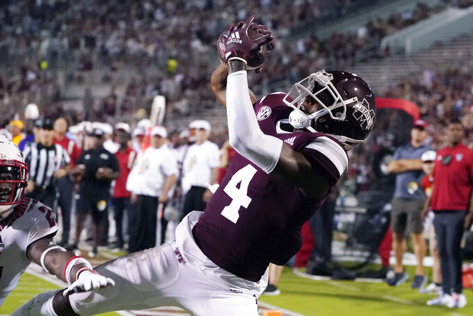 Mississippi State wide receiver Malik Heath (4) reaches for a 21-yard touchdown pass reception during the first half of the team's NCAA college football game against North Carolina State in Starkville, Miss., Saturday, Sept. 11, 2021. (AP Photo/Rogelio V. Solis)