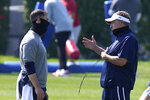 New England Patriots equipment manager Brenden Murphy, left, speaks with head coach Bill Belichick, right, during an NFL football training camp practice, Sunday, Aug. 23, 2020, in Foxborough, Mass. (AP Photo/Steven Senne, Pool)