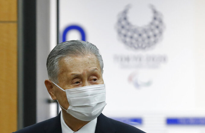 Yoshiro Mori, the president of the Tokyo Olympic organizing committee, enters a venue for a news conference in Tokyo Thursday, Feb. 4, 2021. (Kim Kyung-hoon/Pool Photo via AP)