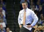 Florida head coach Mike White watches his team during the second half of an NCAA college basketball game against Kentucky in Lexington, Ky., Saturday, March 9, 2019. Kentucky won 66-57. (AP Photo/James Crisp)