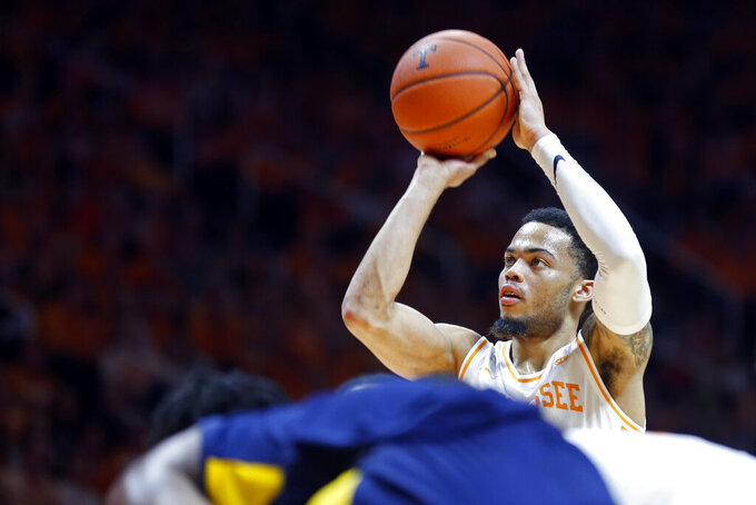 Tennessee guard Lamonte Turner (1) shoots a free throw in the second half of an NCAA college basketball game against West Virginia, Saturday, Jan. 26, 2019, in Knoxville, Tenn. Tennessee won 83-66. (AP Photo/Wade Payne)