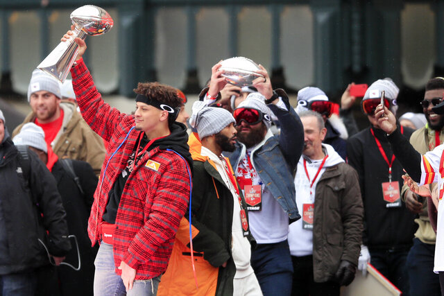 Kansas City Chiefs quarterback Patrick Mahomes holds the Vince Lombardi trophy during a Super Bowl rally in Kansas City, Mo., Wednesday, Feb. 5, 2020. (AP Photo/Orlin Wagner)