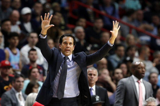 FILE - In this Feb. 28, 2020, file photo, Miami Heat head coach Erik Spoelstra calls out a play during the second half of an NBA basketball game against the Dallas Mavericks in Miami. The Heat enter the NBA restart fourth in the Eastern Conference. (AP Photo/Wilfredo Lee, File)