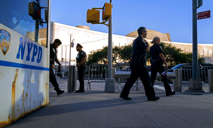 Members of the New York City Police Department walk near the United Nations headquarters, Sunday, Sept. 19, 2021, in New York. The 76th Session of the U.N. General Assembly begins this week. (AP Photo/Craig Ruttle)