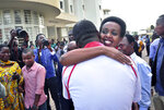 Diane Rwigara, the country's most prominent opposition figure, is hugged by a wellwisher after being acquitted of charges related to her election challenge of President Paul Kagame, at the high court in Kigali, Rwanda Thursday, Dec. 6, 2018. Rwanda's high court on Thursday acquitted Rwigara of all charges, as judges said the prosecution failed to provide proof of insurrection and forgery. (AP Photo)