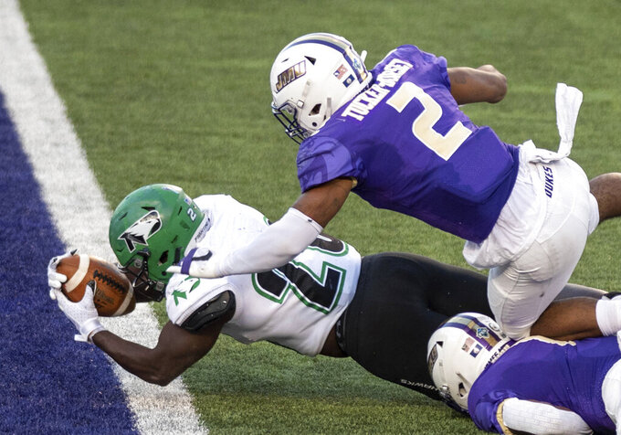 North Dakota running back Otis Weah (26) dives in under James Madison linebacker Diamonte Tucker-Dorsey (2) for a touchdown during the first half of a quarterfinal game in the NCAA FCS football playoffs in Harrisonburg, Va., Sunday, May 2, 2021. (Daniel Lin/Daily News-Record via AP)