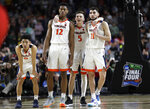 Virginia players Kihei Clark, from left, De'Andre Hunter, Kyle Guy and Ty Jerome celebrate at the end of the championship game against Texas Tech in the Final Four NCAA college basketball tournament, Monday, April 8, 2019, in Minneapolis. Virginia won 85-77 in overtime. (AP Photo/David J. Phillip)