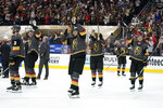 Vegas Golden Knights celebrate after defeating the Colorado Avalanche in Game 6 of an NHL hockey Stanley Cup second-round playoff series Thursday, June 10, 2021, in Las Vegas. (AP Photo/John Locher)