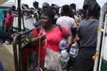 Haitian migrants prepare to board a boat that will take them to Acandi, near the border with Panama, from Necocli, Colombia, Monday, Sept. 13, 2021. Migrants have been gathering in Necocli as they move north on their way to the U.S. border. (AP Photo/Fernando Vergara)