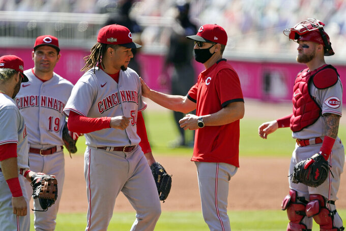 Cincinnati Reds starting pitcher Luis Castillo, center left, is relieved by manager David Bell during the sixth inning against the Atlanta Braves in Game 2 of a National League wild-card baseball series, Thursday, Oct. 1, 2020, in Atlanta. (AP Photo/John Bazemore)