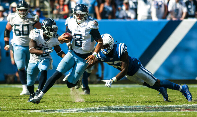 Tennessee Titans quarterback Marcus Mariota (8) avoids a tackle attempt by Indianapolis Colts outside linebacker Darius Leonard (53) during Indianapolis' 19-17 win over the Titans on Sunday, September 15, 2019, at Nissan Stadium. (Austin Anthony/Daily News via AP)