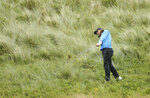 England's Tommy Fleetwood plays from the rough on the 7th hole during the final round of the British Open Golf Championships at Royal Portrush in Northern Ireland, Sunday, July 21, 2019.(AP Photo/Peter Morrison)