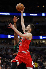 Chicago Bulls guard Tomas Satoransky, right, drives to the basket against Boston Celtics guard Marcus Smart during the first half of an NBA basketball game in Chicago, Saturday, Jan. 4, 2020. (AP Photo/Nam Y. Huh)