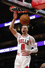 Chicago Bulls guard Zach LaVine (8) scores in the first half of an NBA basketball game against the Atlanta Hawks Wednesday, Nov. 6, 2019, in Atlanta. (AP Photo/John Bazemore)
