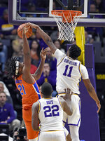 LSU forward Kavell Bigby-Williams (11) blocks the shot of Florida forward Dontay Bassett (21) as LSU forward Darius Days (22) watches during the first half of an NCAA college basketball game Wednesday, Feb. 20, 2019, in Baton Rouge, La. (AP Photo/Bill Feig)