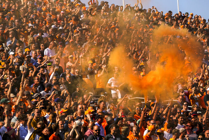Dutch fans cheer during the qualifying session for Sunday's Formula One Dutch Grand Prix, at the Zandvoort racetrack, Netherlands, Saturday, Sept. 4, 2021. Red Bull driver Max Verstappen of the Netherlands clinched the pole position.
