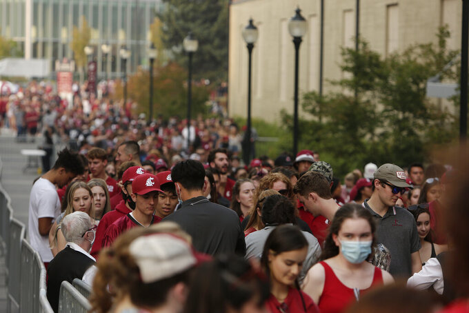 Washington State students enter Martin Stadium before an NCAA college football game between Washington State and Utah State, Saturday, Sept. 4, 2021, in Pullman, Wash. (AP Photo/Young Kwak)