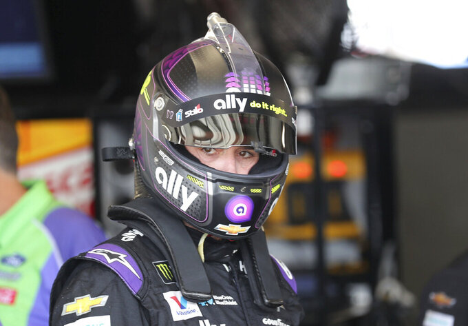 Jimmie Johnson gets ready to head out for the second practice run for the NASCAR Cup Series auto race at Watkins Glen International, Saturday, Aug. 3, 2019, in Watkins Glen, New York. (AP Photo/John Munson)
