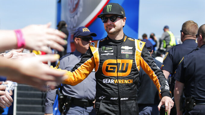 NASCAR Cup Series driver Kurt Busch (1) greets fans during driver introductions prior to the NASCAR Cup Series auto race at the Martinsville Speedway in Martinsville, Va., Sunday, March 24, 2019. (AP Photo/Steve Helber)