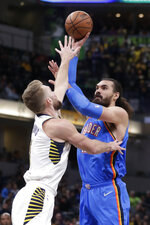 Oklahoma City Thunder center Steven Adams (12) shoots over Indiana Pacers forward Domantas Sabonis during the first half of an NBA basketball game in Indianapolis, Tuesday, Nov. 12, 2019. (AP Photo/Michael Conroy)