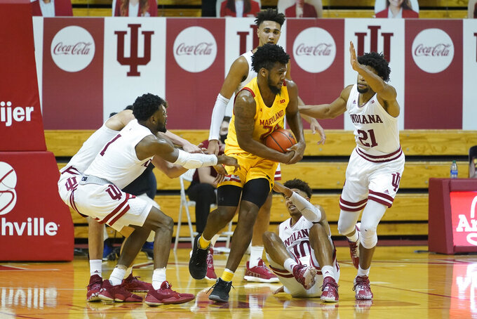 Maryland forward Donta Scott (24) controls the ball during the second half of an NCAA college basketball game against Indiana, Monday, Jan. 4, 2021, in Bloomington, Ind. (AP Photo/Darron Cummings)
