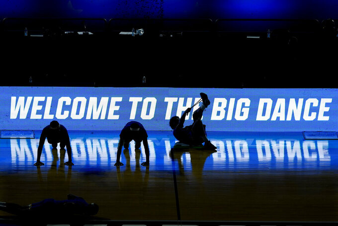 Morehead State players stretch before a college basketball game against West Virginia in the first round of the NCAA tournament at Lucas Oil Stadium Friday, March 19, 2021, in Indianapolis. (AP Photo/Mark Humphrey)