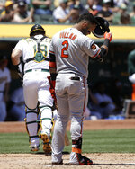 Baltimore Orioles' Jonathan Villar (2) reacts after striking out against the Oakland Athletics a baseball game in Oakland, Calif., Wednesday, June 19, 2019. At left is Athletics catcher Josh Phegley. (AP Photo/Jeff Chiu)