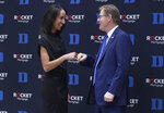 Nina King fist-bumps Duke President Vincent Price after a press conference where she was introduced as Duke's new athletic director, Friday, May 21, 2021, at Cameron Indoor Stadium in Durham, N.C. (Ethan Hyman/The News & Observer via AP)