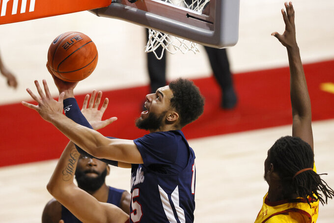 Jackson State forward Hezekiah Quinlan, center, finds his way around Iowa State forward Solomon Young, right, for a layup during the first half of an NCAA college basketball game, Sunday, Dec. 20, 2020, in Ames, Iowa. (AP Photo/Matthew Putney)
