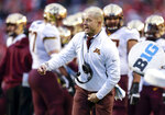 Minnesota head football coach P.J. Fleck argues with officials during the first half of an NCAA college football game against Wisconsin Saturday, Nov. 24, 2018, in Madison, Wis. (AP Photo/Andy Manis)