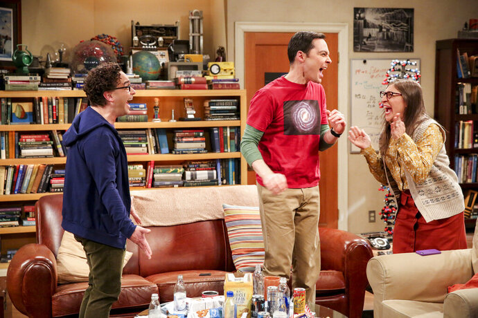 This photo provided by CBS shows Johnny Galecki, from left, Jim Parsons and Mayim Bialik in a scene from the series finale of